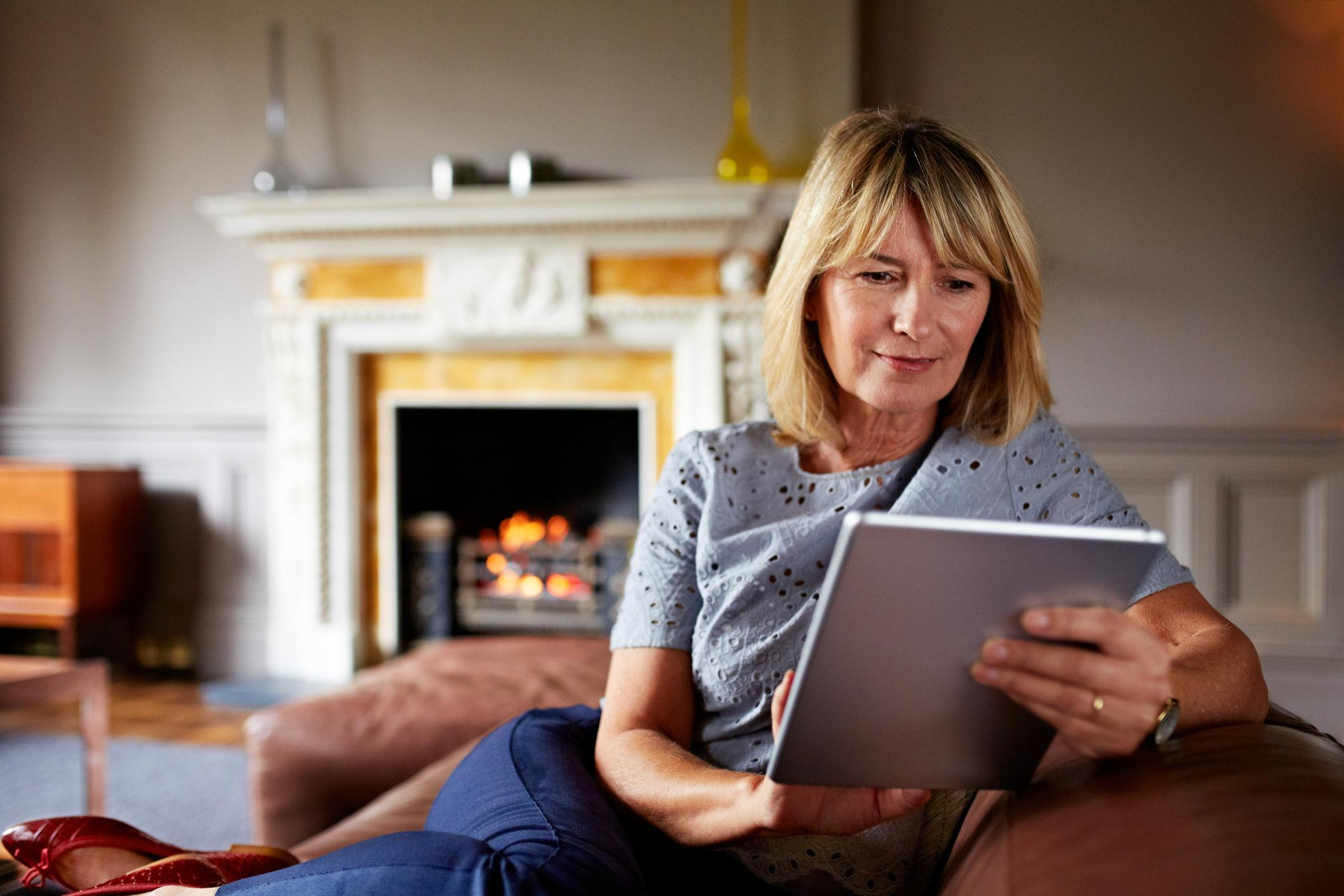 Woman by fire with tablet